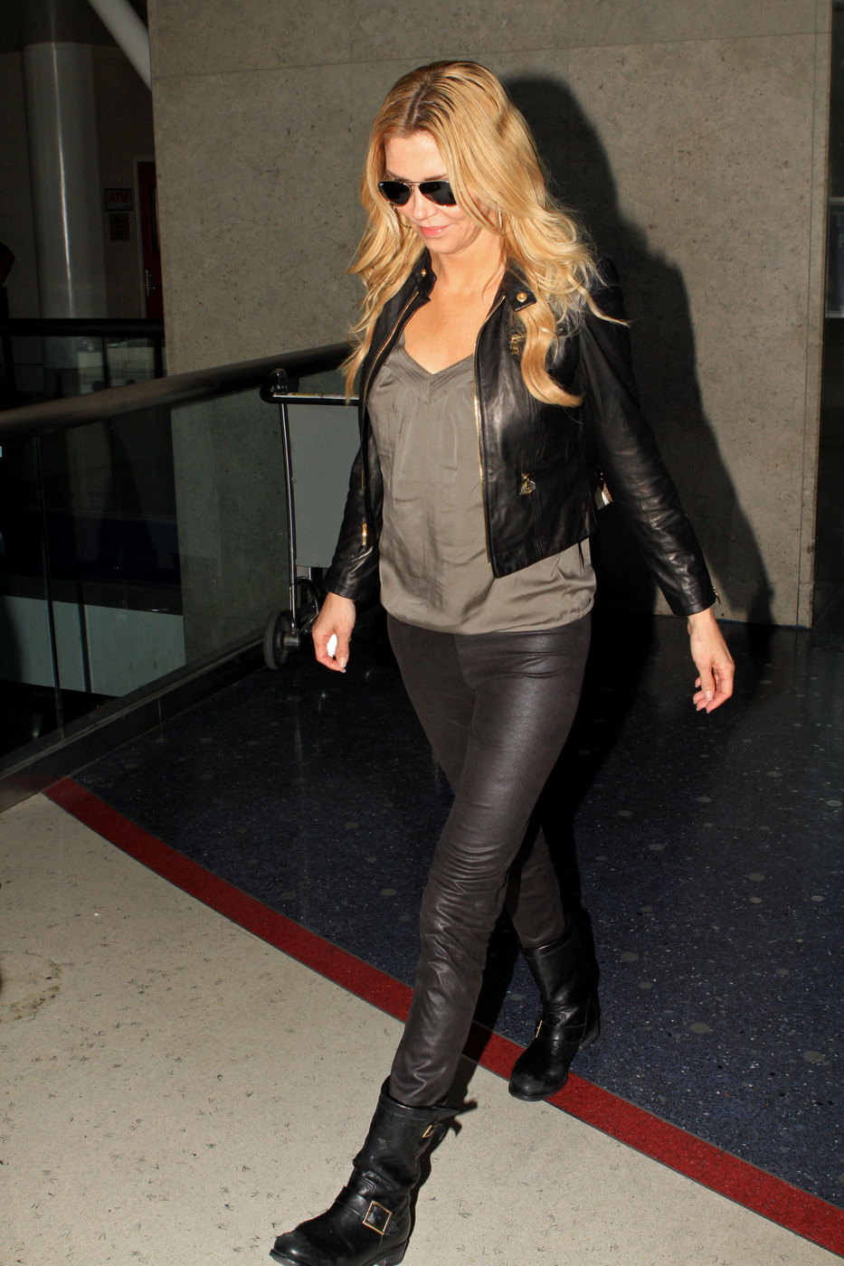 Brandi Glanville rocks leather pants and leather jacket as she makes